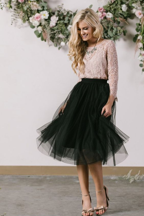 a black tulle skirt, a dusty pink lace top with sleeves, a statement necklace and nude heels