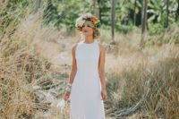 10 a chic modern halter neckline wedding dress with a front slit and a front seam plus bold emerald shoes
