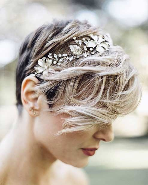 a pixie haircut with waves and a floral rhinestone headband looks wow and very feminine
