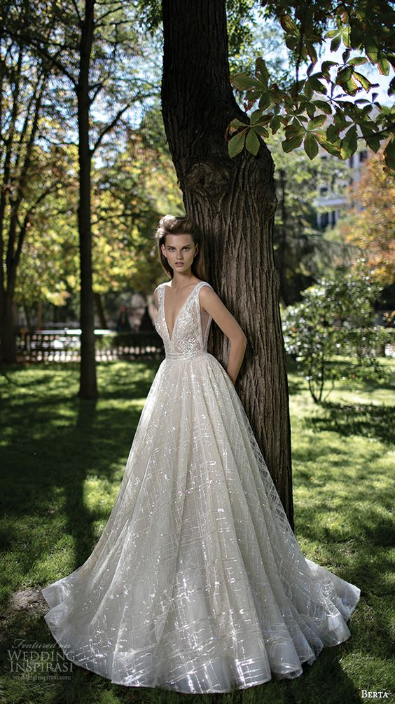 a sparkling plunging neckline wedding dress with wide straps and a plunging neckline to make a statement