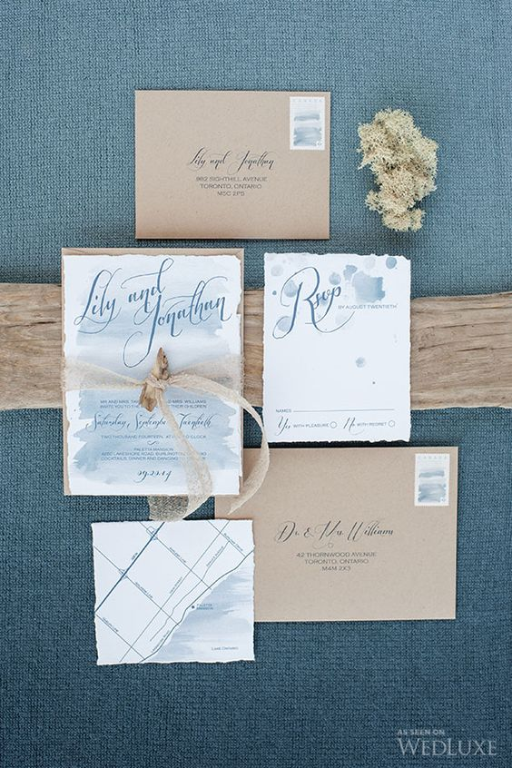pastel blue watercolor wedding invitations and kraft paper envelopes for a beach wedding