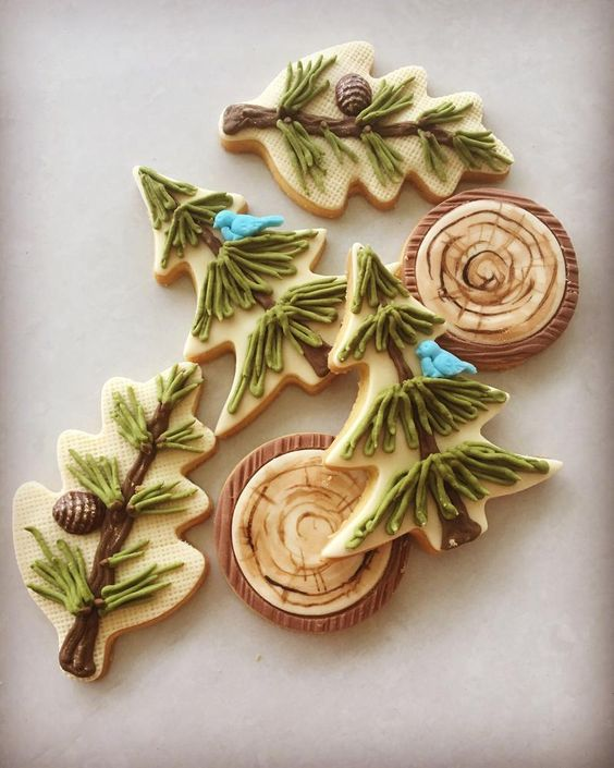 woodland-inspired cookies with fir trees, pinecones and wood slices are amazing for a woodland winter wedding