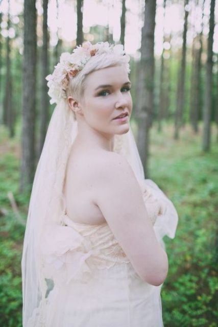 a pixie haircut with a fresh floral crown in beautiful pastel shades and a veil added