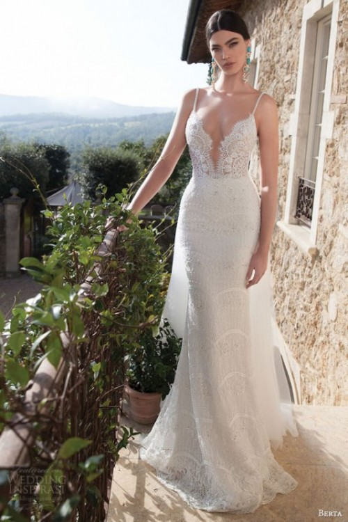 a spaghetti strap lace sheath wedding dress with a plunging neckline looks extremely sexy