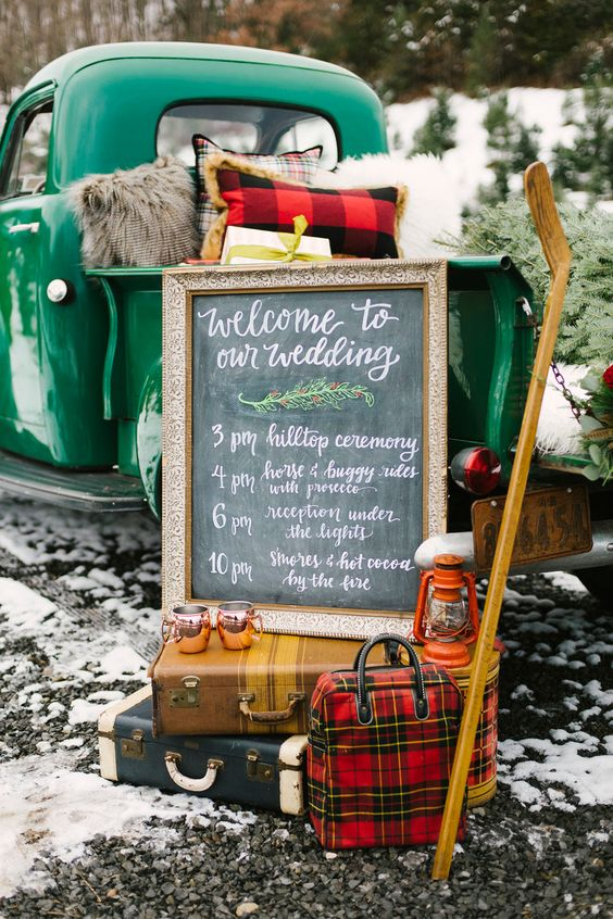 vintage rustic decor with a lantern, some suitcases and a chalkboard sign in a frame