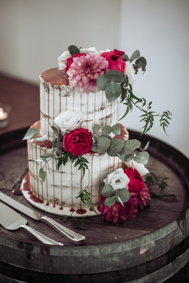 The wedding cake was a semi naked one, with dripping, greenery and flowers