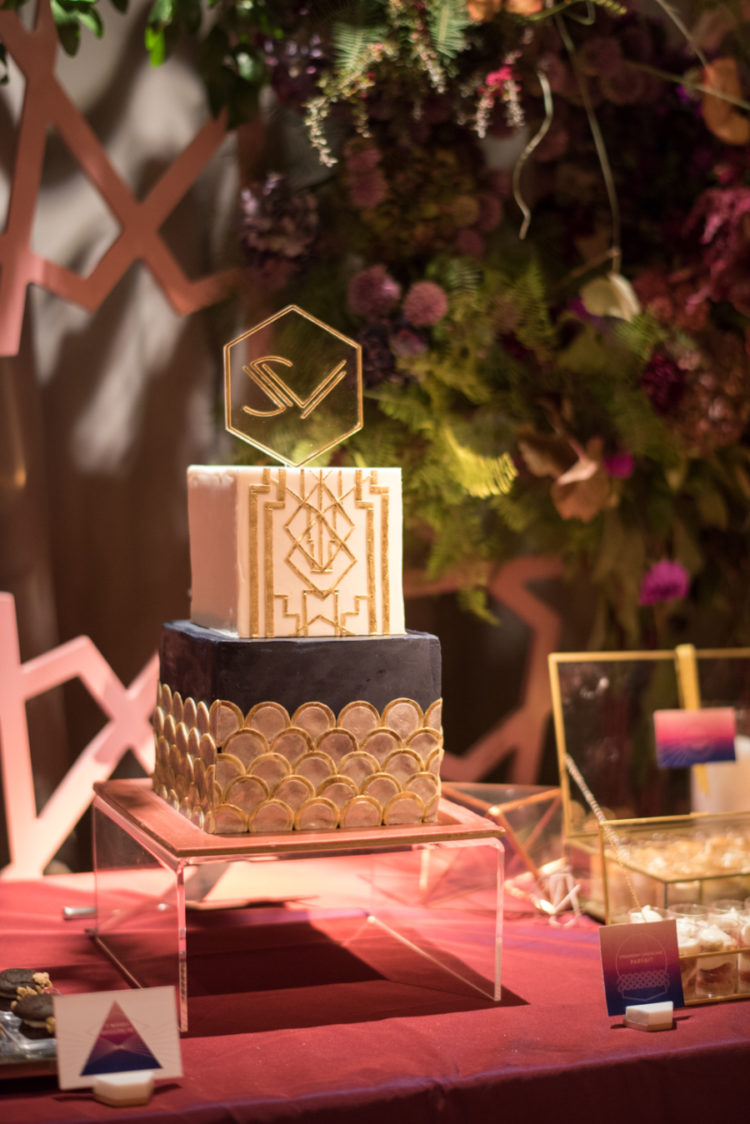 The wedding cake was art deco, a square one with gold art deco details and an acrylic topper