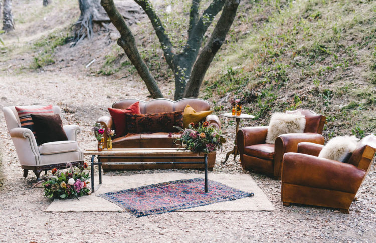 The wedidng lounge was done with leather furniture and lush blooms all over