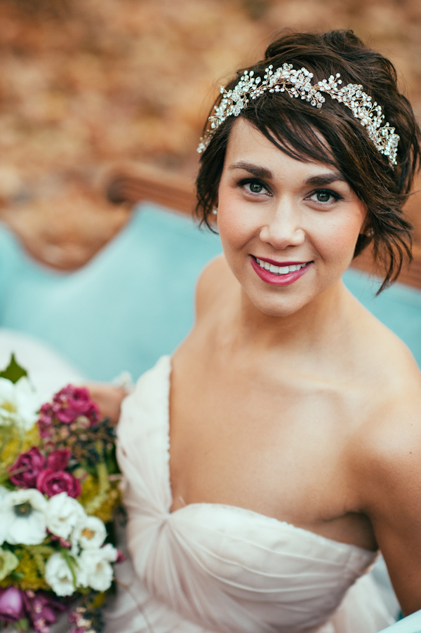 a chic wavy hairstyle with a rhinestone headband and a berry lip will make you stand out for sure