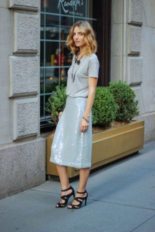 a grey shirt, two layered necklaces, a silver sequin midi skirt, black strapppy heels