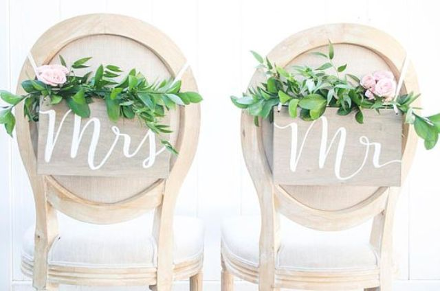 simple wooden signs with greenery and pink blooms for elegant rustic chair decor look chic and nice