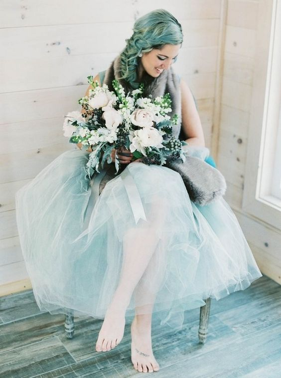 the bride rocking an ice blue tulle skirt, ciy blue hair for a bold frozen winter look