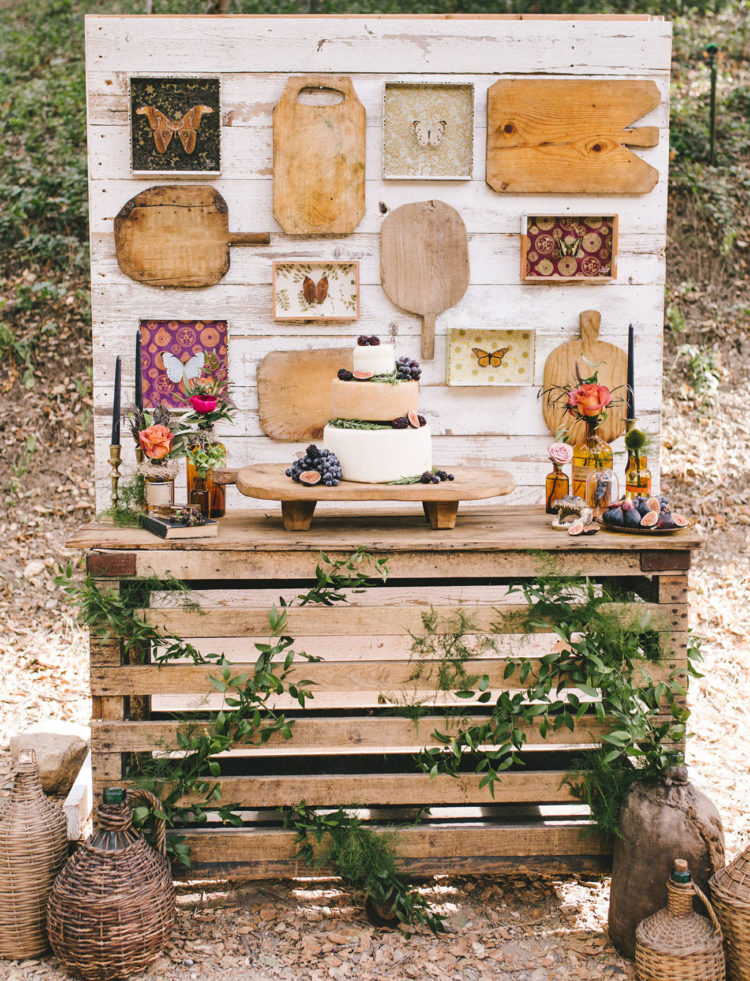 Instead of a wedding cake, the stylists decided on cheese wheels with grapes and figs