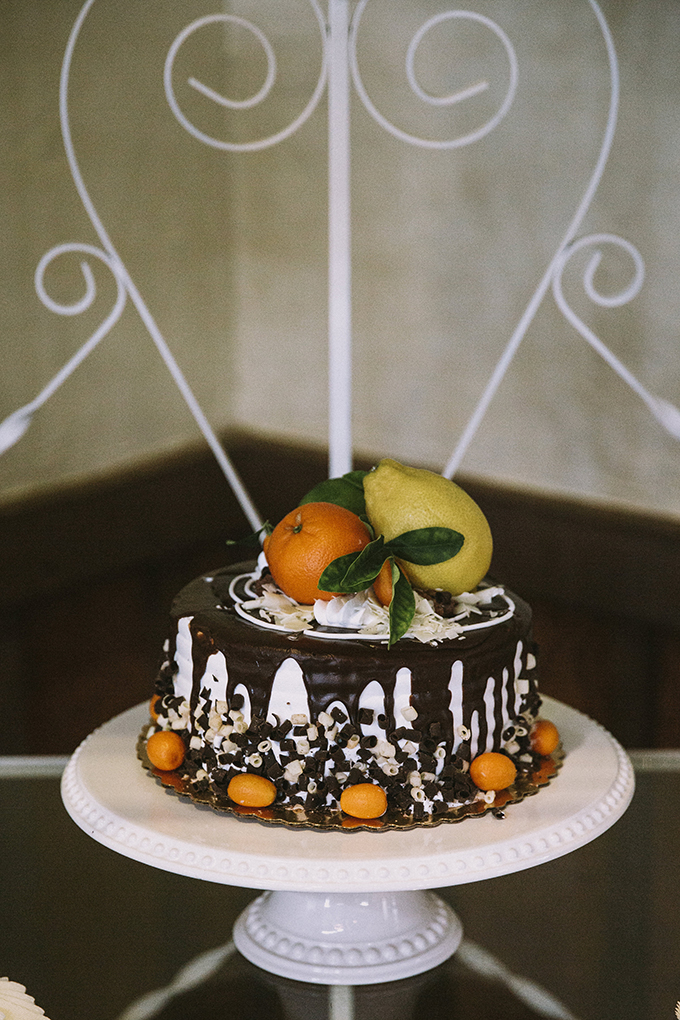 The wedding cake was a white and adark chocolate one with citrus on top
