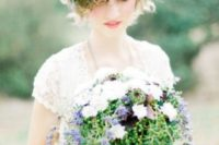 13 a curly hairstyle with a fresh greenery and purple bloom crown and a matching bouquet