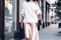 13 a pink midi skirt, a white off the shoulder slouchy sweater, pink velvet shoes with ankle straps