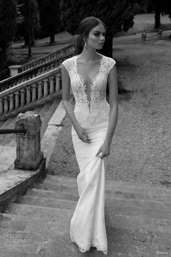 a plunging neckline wedding dress with no sleeves of lace with a textural bodice