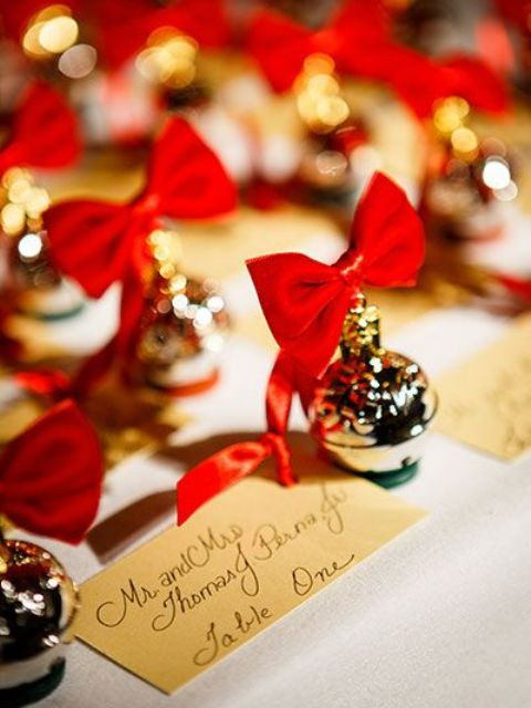 display your escort cards with little cute ornaments with red bows to give them a Christmas feel