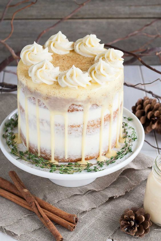 rum spiked eggnog cake with cream cheese frosting and white chocolate ganache looks unusual