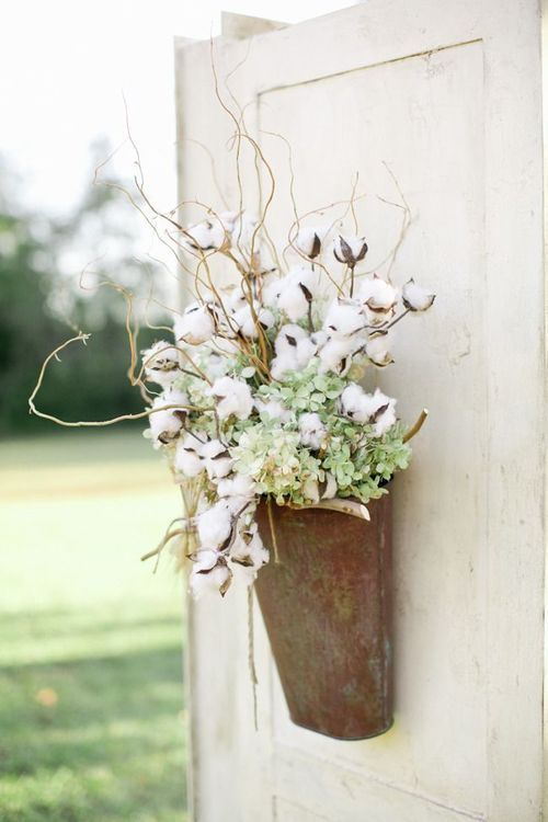 a cotton, green hydrangeas and branch decoration will fit any space of your wedding venue