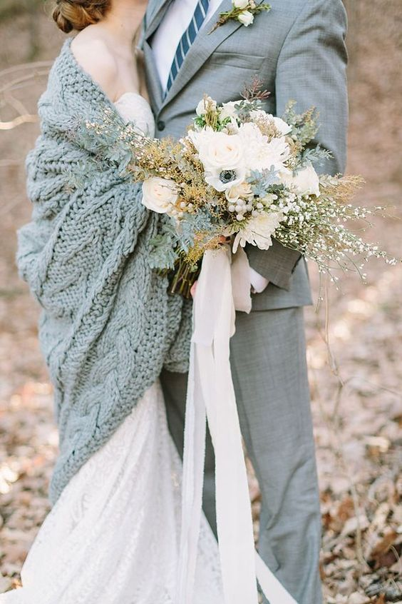 a large cable knit grey coverup matches the groom's suit and keeps the bride warm