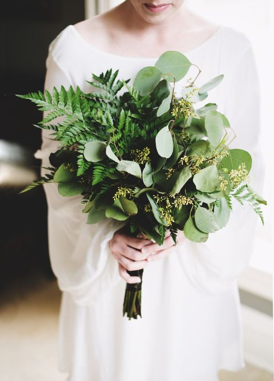 a lush and gorgeous fern and eucalyptus wedding bouquet for a modern winter bride