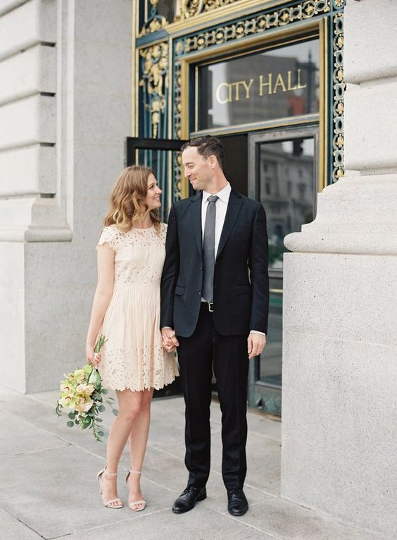 a simple cute lace dress with cap sleeves and a high neckline and matching shoes for a city hall wedding
