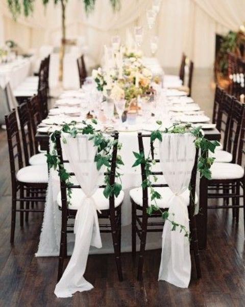 Picture Of Airy White Fabric And Foliage Garlands For Decorating