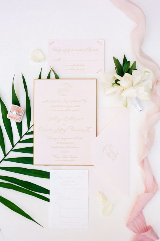 blush wedding stationery with gold calligraphy and framing for a cool tropical wedding