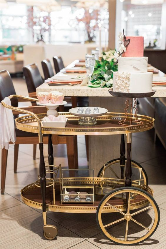 display your wedding cake and desserts on a vintage trolley to make them stand out