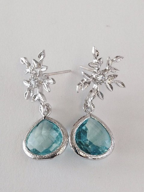 stunning ice blue wedding earrings with floral decor for an ice queen
