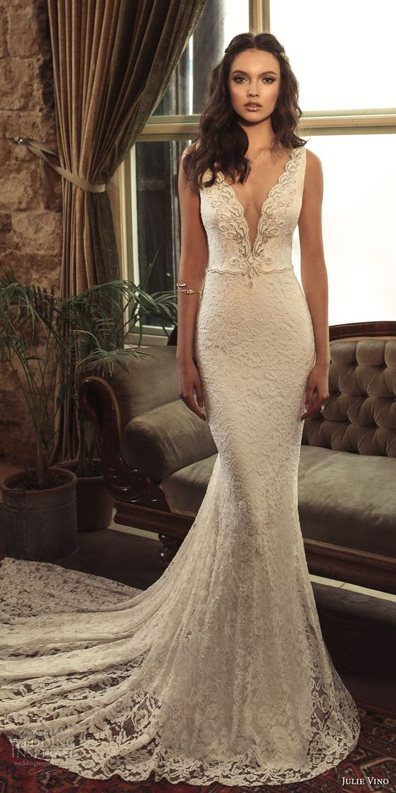 stunning lace mermaid wedding dress with a train, a plunging neckline, embroidery and no sleeves
