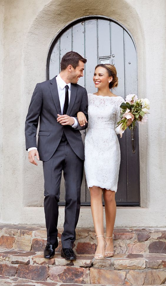 a bateau neckline long sleeve knee wedding dress with a scallope edge is ideal for a city hall ceremony