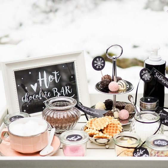a chic hot chocolate bar with a sign, some toppers, tags and gorgeous desserts