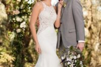 15 a mermaid wedding dress with a lace bodice and a train plus an illusion sweteheart neckline