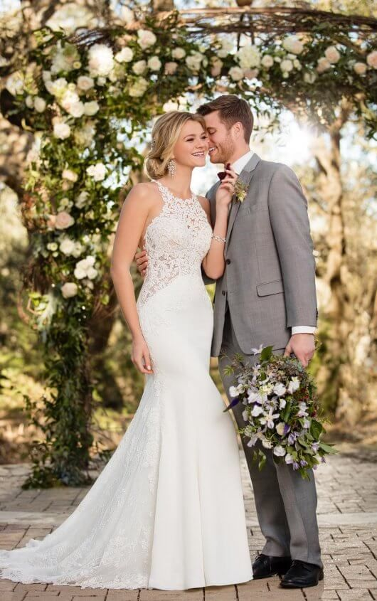 a mermaid wedding dress with a lace bodice and a train plus an illusion sweteheart neckline