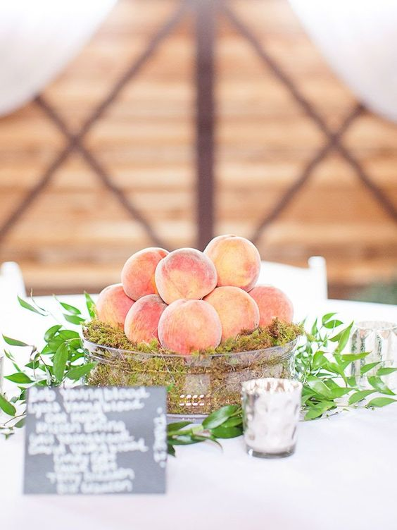 a rustic metal bowl filled with moss and fresh peachies is a gorgeous idea for a soutern wedding