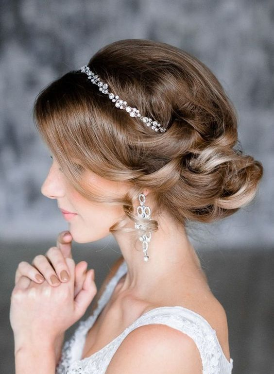 a sparkling silver bead headpiece and matching earrings to add a shiny touch to your bridal look