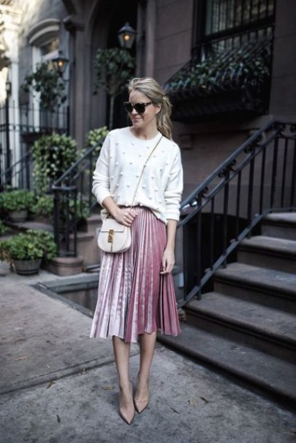 a white pearled sweater, a pink velvet pleated skirt, nude pumps for a cute girlish look