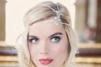 16 a short wavy hairstyle in the 1920s style with a rhinestone headpiece and a red lip for a flawless look