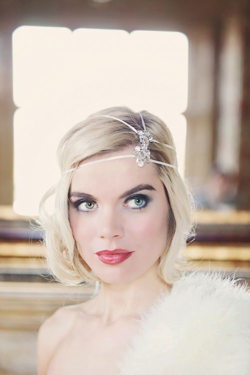 a short wavy hairstyle in the 1920s style with a rhinestone headpiece and a red lip for a flawless look