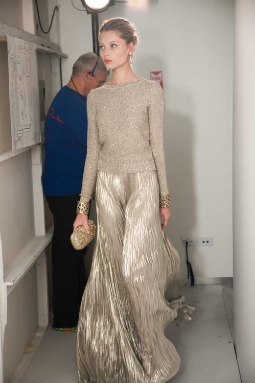 a sparkling neutral sweater, a metallic pleated maxi skirt, statement bracelets and an embellished clutch