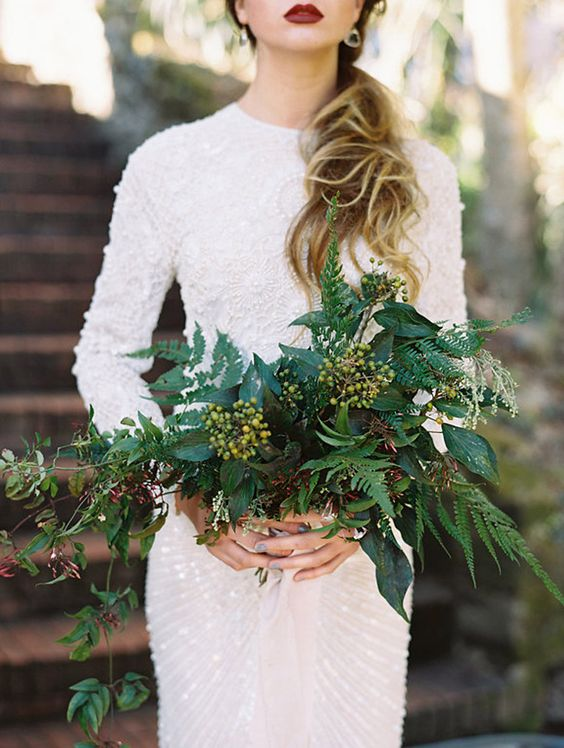 a textural greenery bouquet with berries, and a red lip for a bold bridal look