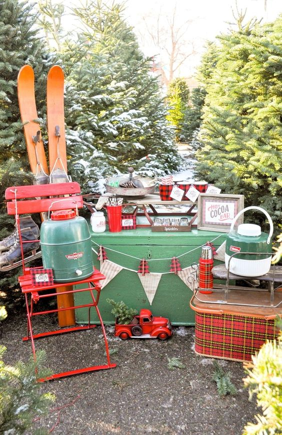 a gorgeous Christmas-inspired bar decorated with skis, plaid mugs and thermoses and banners