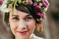 17 a short wavy hairstyle with a lush floral crown with fuchsia blooms, white flowers and greenery and a matching lipstick