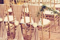 17 blush sequin chair covers with large white blooms are great to decorate a glam wedding aisle