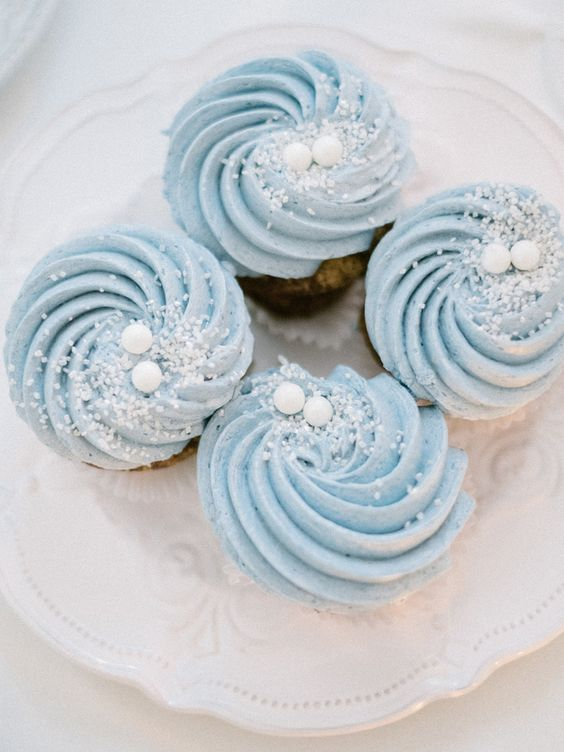 cupcakes with blue swirl frosting, edible snow and snowballs are ideal for a winter wedding