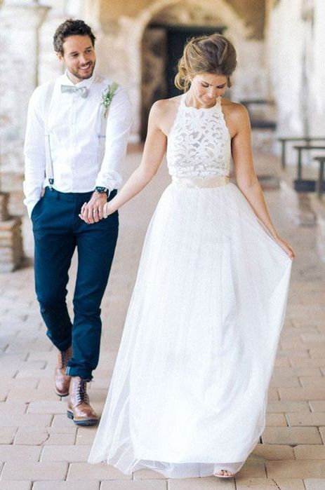 a halter neckline wedding dress with a lace bodice and a layered skirt plus an accent sash on the waist