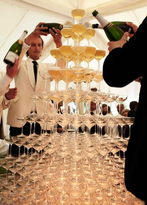 a champagne tower is exactly what you need to surprise and excite your guests