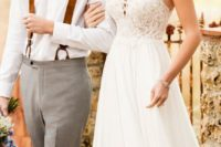 19 a cute wedding dress with a lace bodice and a plain flowy skirt for a relaxed bride